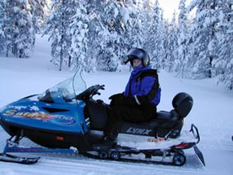 Boundary Waters Canoe Area Wilderness Act - A typical snowmobile in a snowy landscape