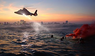 Aviation Survival Technician - Coast Guard rescue swimmers from Coast Guard Air Station Atlantic City train off the coast of Atlantic City, New Jersey.