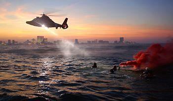 English: Description: Coast Guard rescue swimm...