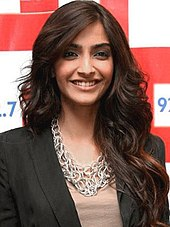Sonam Kapoor is directly looking towards the camera.
