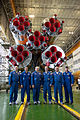 Soyuz TMA-10M crew in front of their booster rocket.jpg