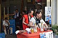 Sparkling rose vendor and resting staff at Azabujuban festival.jpg