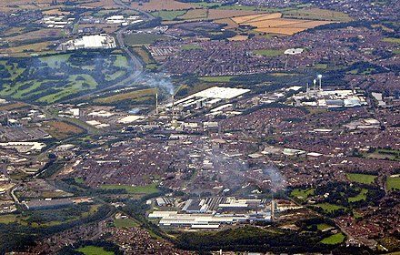 St Helens viewed looking southwest in 2007. The town centre is at centre and the Linkway runs to the top. Sherdley Park is top left. Pilkington Cowley Hill works is bottom centre.