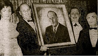 """Stanley Steingut - Stanley Steingut receiving portrait from Crown Heights Yeshiva for """"'distinguished constributions' in fostering educational growth of the community."""" Madeline Steingut on left. Abe Beame on far right."""