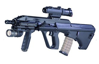 Steyr AUG - A left-side view of the Steyr AUG A3-CQC prototype with a Leupold CQ/T optic and Surefire M900 weaponlight foregrip.