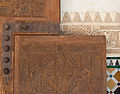 Stucco, wooden door, mosaics, wall Alhambra, Granada, Spain.jpg