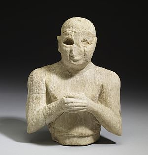 Ninshubur - Ancient Sumerian calcite-alabaster figurine of a male worshipper from sometime between 2500 BC and 2250 BC. The inscription on his right arm states that he is praying to Ninshubur.