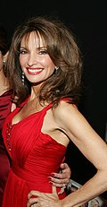 A woman with brunette hair, wearing red outfit.