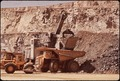 THE DUVAL CORP.'S SIERRITA MINE. THE OPEN PIT MINE IS 300 FT. DEEP AND WILL EVENTUALLY BE WORKED DOWN TO 1800 FT - NARA - 544099.tif