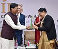 The Minister of State for Agriculture and Farmers Welfare, Shri Sudarshan Bhagat presenting an award, at the celebration to mark the 50th anniversary of the release of the rice variety, IR8, in New Delhi on November 21, 2016 (1).jpg