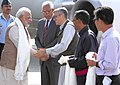 The Prime Minister, Shri Narendra Modi being received by the Chief Minister of Jammu and Kashmir, Shri Omar Abdullah, on arrival at Leh on August 12, 2014. The Governor of Jammu and Kashmir, Shri N.N. Vohra is also seen.jpg