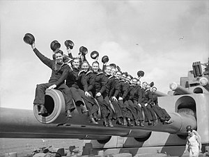 HMS Nelson (28) - Sailors of the South African Royal Naval Volunteer Reserve sitting on one of the 16-inch gun barrels of HMS Nelson during the Second World War.