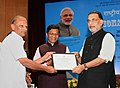 "The Union Minister for Agriculture and Farmers Welfare, Shri Radha Mohan Singh presenting the merit certificate to the Almadhi Semen Station, Tamil Nadu, at the launch of the ""e-pashu haat portal"", in New Delhi.jpg"