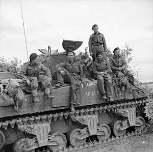 Sherwood Rangers Yeomanry - The crew of a Sherman tank named 'Akilla' of 1st Nottinghamshire Yeomanry, 8th Armoured Brigade, after having destroyed five German tanks in a day, Rauray, Normandy, 30 June 1944. (IWM B6222)