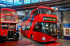 London Transport Museum - A New Routemaster bus alongside a 1954 AEC Regent III RT inside the London Transport Museum