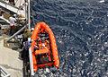The rigid-hull inflatable (RHIB) boat from the Military Sealift Command fleet replenishment oiler USNS John Ericsson (T-AO 194) returns to the ship 100714-N-XXXXT-325.jpg