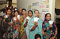 The women voters displaying their identity card, at a polling booth, during the 5th Phase of General Elections-2014, at Shirdi, Maharashtra on April 17, 2014.jpg