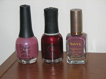 English: Three bottles of different nail polis...