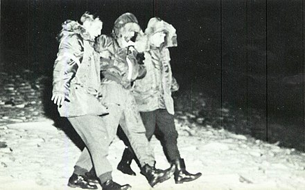 The gunner (center), SSgt Calvin Snapp, is rescued after ejecting onto the ice Thule AFB B-52 Gunner Rescue.jpg