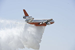 "Aerial firefighting - A DC-10 Tanker operated by a private contractor for the U.S. Forest Service demonstrates a water drop during ""Thunder Over The Empire Air Fest"" at March Air Reserve Base, Calif. (2012)"