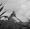 Toni Frissell - Frida Kahlo, seated next to an agave.png