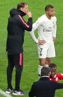 Tuchel with Kylian Mbappe, who was a regular in Tuchel's team Tuchel & Mbappe PSG 2019.jpg