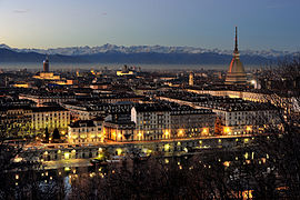Turin with Mole Antonelliana and the Alps in the background.