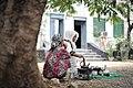 Two Ethiopian women prepare coffee for visiting AMISOM officials to Baidoa, Somalia, on June 20. AMISOM Photo - Tobin Jones (14280976480).jpg