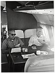 Two unidentified men playing cards (10290641205).jpg