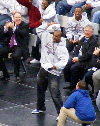 Helmet Catch - Tyree re-enacts his catch during the victory rally at Giants Stadium after the Super Bowl.