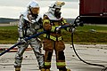 U.S. Air Force firefighters prepare to extinguish flames during a training exercise on a concrete pad known as a burn pad at Spangdahlem Air Base, Germany, Jan. 8, 2014 140108-F-OP138-143.jpg