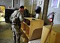 U.S. Army Spc. Nicholas Cerreto, a member of the Farah Provincial Reconstruction Team (PRT), prepares for a mission to Farah, Afghanistan, Aug. 29, 2012 120829-N-II659-0344.jpg