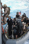 U.S. Coast Guard Lt. Aaron Renschler, team leader of Tactical Law Enforcement Detachment 406, loads a rigid-hull inflatable boat with members of the visit, board, search and seizure team, currently embarked 100524-N-EF447-001.jpg