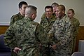 U.S. Marine Corps Sgt. Brandon Saunders, second from right, a combat correspondent with the III Marine Expeditionary Force consolidated public affairs office, shakes hands with Japan Ground Self-Defense Force 120513-F-MQ656-253.jpg
