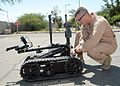 U.S. Navy Explosive Ordnance Disposal Technician 2nd Class Erik Gill, assigned to Explosive Ordnance Disposal Mobile Unit (EODMU) 6, prepares a robot designed to remotely handle ordnance material during 130326-N-RE144-166.jpg