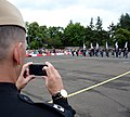 U.S. Navy Lt. David Latour, left foreground, the director of the U.S. Naval Forces Europe Band, takes a photo of members of the Swiss Top Secret Drum Corps percussionist team as they rehearse their segment 120801-N-VT117-2080.jpg