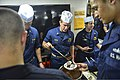 U.S. Navy officers aboard the guided missile cruiser USS Monterey (CG 61) host an ice cream social on the ship's mess decks May 10, 2013, in the Gulf of Aden 130510-N-QL471-812.jpg