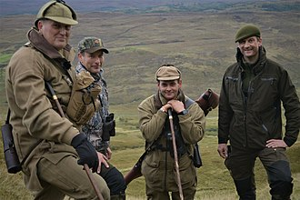 Gamekeepers in the United Kingdom - Gamekeeper Niall Rowantree (leftmost) taking out a guest (on his right) deer stalking on Ardnamurchan Estate in Scotland