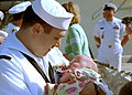 US Navy 020416-N-4374S-501 Sailor meets daughter for the first time.jpg