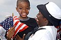 US Navy 030613-N-6607P-005 A Sailor from the amphibious command and control ship USS Mount Whitney (LCC-JCC 20) rejoices after being reunited with her family.jpg