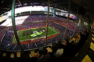 2003 Houston Bowl - Image: US Navy 031230 N 6213R 502 The U.S. Naval Academy Brigade of Midshipmen marches onto the field as seen from the press box in the EV1.Net Houston Bowl at Reliant Stadium in Houston, Texas