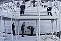 US Navy 040219-N-6477M-184 Deck department personnel complete re-painting the ship from a scaffold barge.jpg