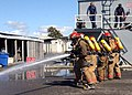 US Navy 040319-N-3019M-008 Sailors assigned to the guided missile cruiser USS Lake Erie (CG 70) work a fire hose as part of the Damage Control Olympics held at Afloat Training Group, Middle Pacific aboard Naval Base Pearl Harbo.jpg