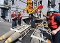 US Navy 040423-N-4190W-011 Deck department personnel aboard the fast combat support ship USS Seattle (AOE 3) transport ammunition to USS John F. Kennedy (CV 67).jpg