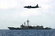 US Navy 040813-N-0507C-001 The guided missile frigate USS Crommelin (FFG 37) and an Argentinean P-3 aircraft patrol the northern approach to the Panama Canal