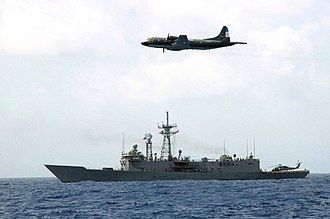 Argentine Navy - A US guided missile frigate and an Argentine maritime patrol aircraft during joint operations in Panama.