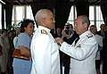 US Navy 041108-N-0000X-001 Argentinean Chief of Naval Operations, Adm. Jorge Godoy, right, presents the Distinguished Service Naval Cross to Commander, U.S. Naval Forces Southern Command, Rear Adm. Vinson E. Smith.jpg