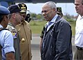 US Navy 050105-N-5376G-013 Secretary of State Colin Powell greets Commander, Carrier Strike Group Nine (CSG-9), Rear Adm. Doug Crowder, after landing at the Sultan Iskandar Muda Airport in Aceh, Sumatra, Indonesia.jpg