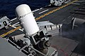 US Navy 051013-N-9222M-013 A Close-In Weapon System (CIWS) fires during a Pre-Aim Calibration (PAC) fire aboard the amphibious assault ship USS Essex (LHD 2).jpg