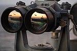 US Navy 051104-N-2984R-004 The Nimitz-class aircraft carrier USS Dwight D. Eisenhower (CVN 69) is reflected in a set of Big Eyes binoculars on the signal bridge of the Nimitz-class aircraft carrier USS Harry S. Truman (CVN 75).jpg